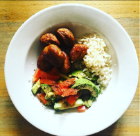 Home made, meatballs, avocado salad with tomatoes and brown rice